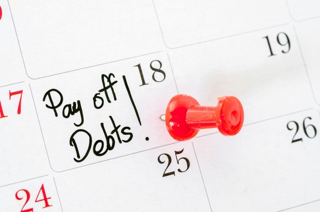 the words pay off debts written