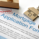approved mortgage application form with house key
