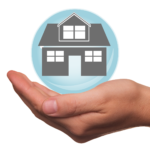 Hand and a home as a representation of mortgage insurance
