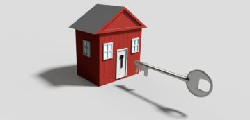 Red small house and a floating key