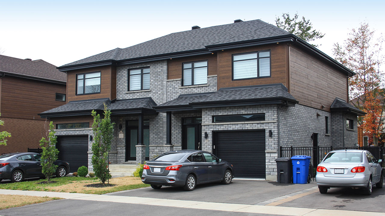 a duplex style of house with car garages