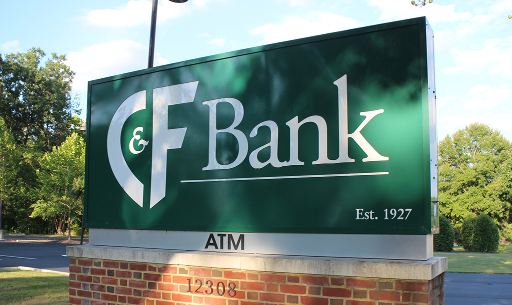 CF Bank post along the road