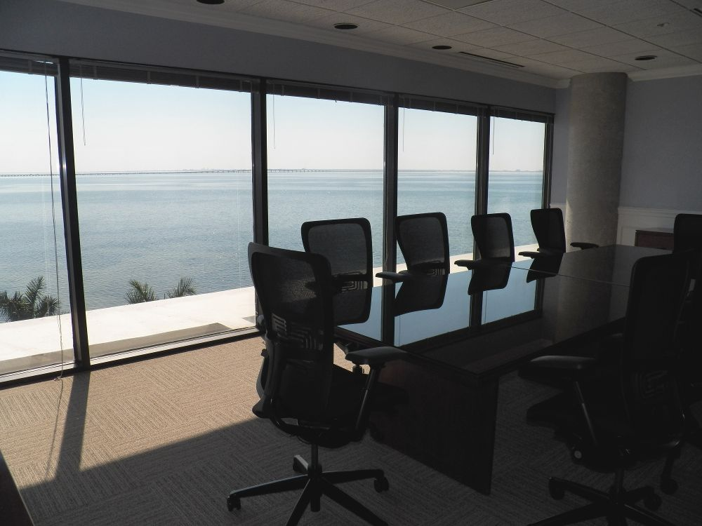 an executive meeting room with the view of the sea