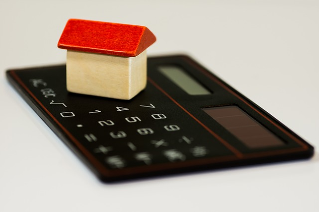 calculator with small house on top graphic