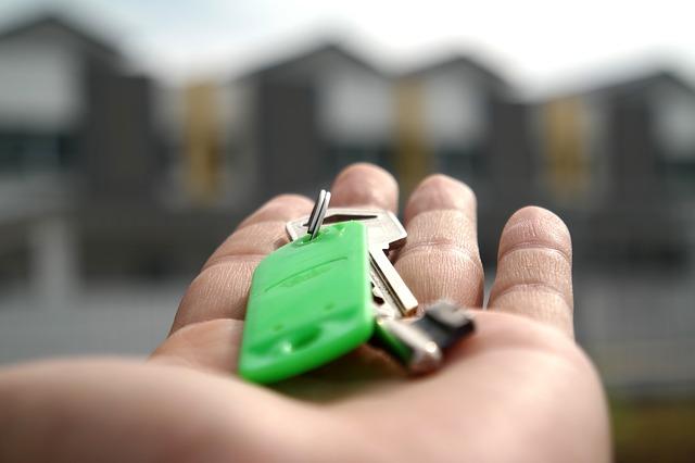 key of a house on a palm